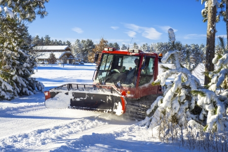 a ski trail groomer comes out, after a fresh snowfall, in bunker hills regional park, minnesota. Stock Photo - 17471745