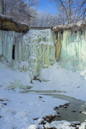 a frozen minnehaha falls and open minnehaha creek in winter, minneapolis, minnesota  Stock Photo