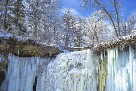 upper half: looking towards the upper half of a frozen minnehaha falls and in winter, minneapolis, minnesota