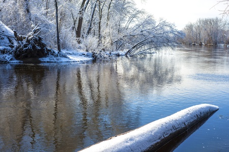 rice creek enters the mississippi river at manomin county park, fridley, minnesota, winter.