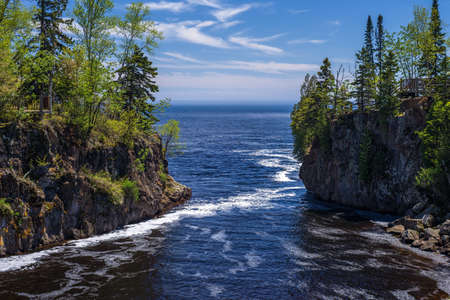 temperance: the foamy temperance river flows out into lake superior