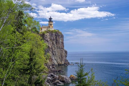superiors: split rock lighthouse sits on a 130 foot cliff, above the cold waters of lake superiors north shore, minnesota  Stock Photo
