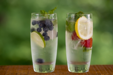 water on leaf: 2 glasses of infused water makes a delicious and healthy summer drink  Stock Photo