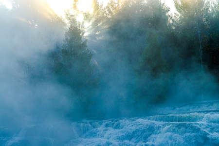 rushing water: a cold morning in autumn creates a misty sunrise over bond falls, upper peninsula michigan