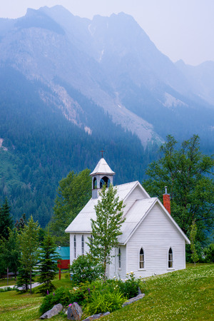saint joseph roman catholic church sits on a hill in the town of field, british columbia, canada  the haze in the air is do to a forest fire north of this location