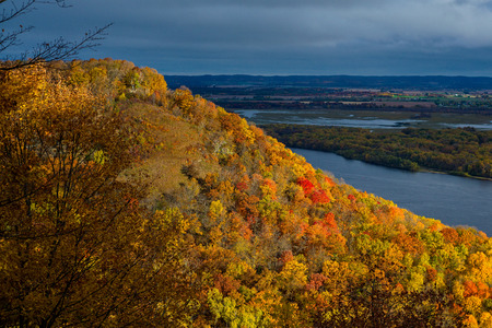 bluff: a glowing sunlit miississippi river bluff lumes over the miississippi river in riverbluff state park, minnesota, autumn. Stock Photo