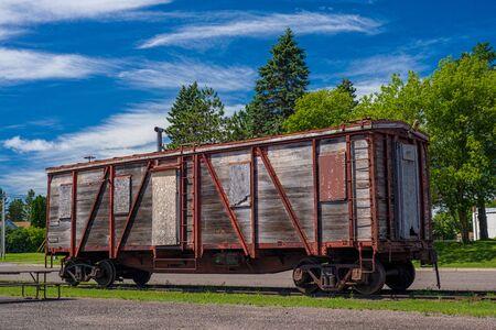 boxcar train: a weathered boxcar rests near the onamia historic train depot, onamia, minnesota. Stock Photo