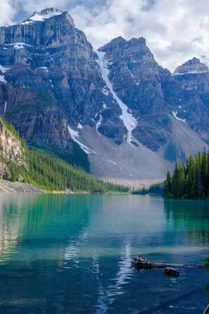 banff: three of the ten peaks are visible here, in the valley of ten peaks, which form the backdrop of moraine lake, in banff national park, alberta, canada. Stock Photo