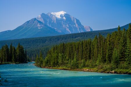 banff: mount temple rises high avove the bow river and bow river valley in banff national park, canada. Stock Photo