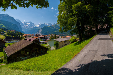 straddle: the backroads and village of wengen switzerland straddle high above the lauterbrunnen valley.