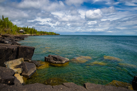 boulders along a rocky coast, on lake superiors north shore, spring, minnesota. Stock Photo