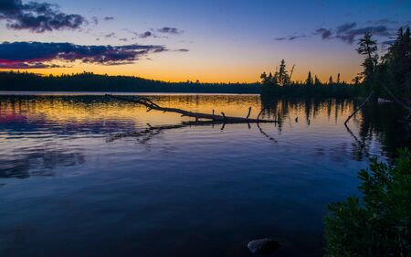 dusk falls over sawbill lake in the boundary waters canoe area wilderness, minnesota.