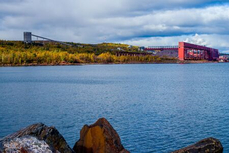 iron ore mining is one of northeast minnesotas largest industries. the ore is brought by rail to this prococessing plant on the shores of lake superior, in silver bay, minnesota. Stock Photo