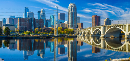 the 3rd avenue bridge crosses over the mississippi river toward the minneapolis skyline, autumn