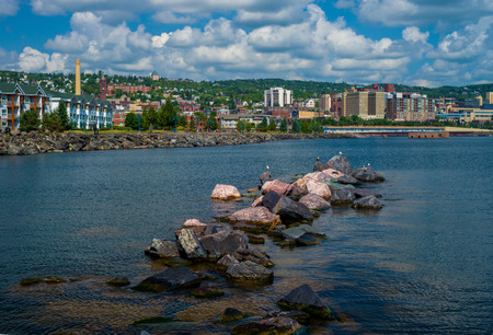 a view of the lake superior waterfront from canal park, and the duluth skyline, mn.