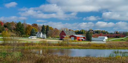 a rural farm in washington county, is surrounded in the colors of autmn, minnesota