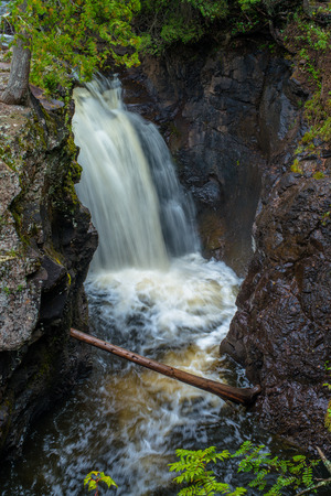 one of a number of falls along the cascade river, flowing down towards lake superior, cascade river state park, minnesota.