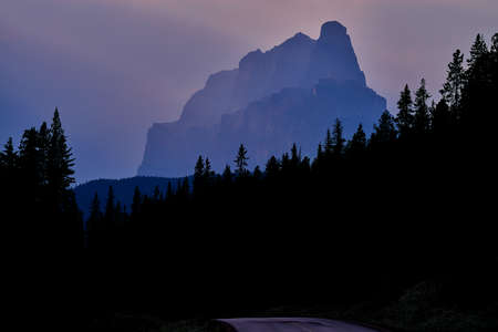 a view of castle mountain along the bow valley parkway, near sunset, banff national park, canada.