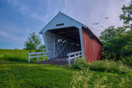 the historic imes covered bridge, spans across clanton creek, near saint charles, iowa.