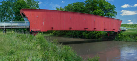 the historic hogback covered bridge, spans across the middle river, near winterset, iowa