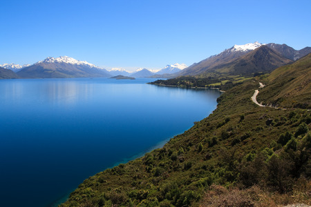 new scenery: Scenic view of Lake Wakatipu with Southern Alps in background near Queenstown, South Island, New Zealand Stock Photo
