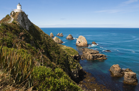 nugget: Light house on nugget point in the catlins, new zealand Stock Photo