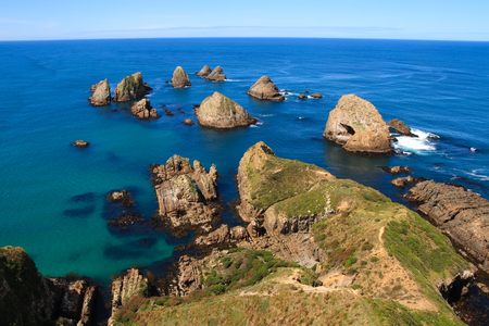 bluff: Nugget point rocks in the catlins, new zealand Stock Photo