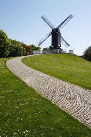 clear path: Windmill and path with a clear blue sky in Bruges, Belgium, Europe