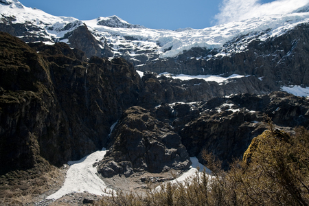 rob: Dramatic rob roy glacier hanging over mountain face, new zealand Stock Photo