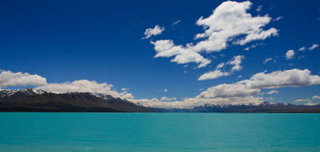 polarised: Beautiful mountain turquoise lake, deep blue sky and snow peaks. Mount Cook National Park, New Zealand