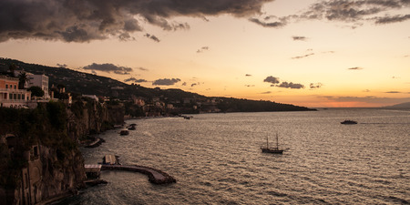 Boats in the evening sunset in Sorrento Bay, Campania, Italy. Stock Photo