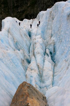 crevasse: Glacier Hike across ice crevasse in Franz Joseph, New Zealand