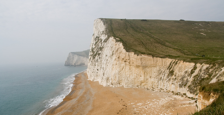 dorset: White Coast Cliffs in Lulworth Cove, Dorset, South England
