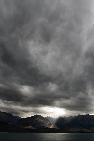 Dark moody sky over mountain range, new zealand Stock Photo