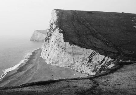 dorset: Black and White Coast Cliffs in Lulworth Cove, Dorset, South England