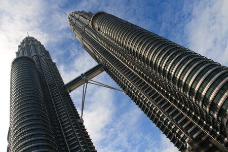 future twin: Petronas Twin Towers with blue sky background Editorial