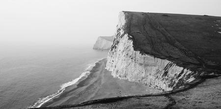 sea cliff: Black and White Coast Cliffs in Lulworth Cove, Dorset, South England