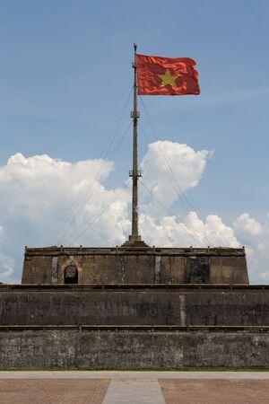 Vietnam flag standing on flag pole above historic hue citadel vietnam flag standing on flag pole above historic hue citadel wall sciox Image collections