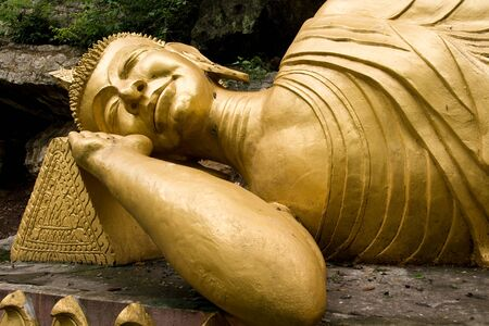 buddha face: Gold Sleeping Buddha in Phou Si Hill, Luang Prabang, Laos Stock Photo