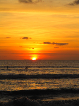 kuta: Sunset Surfing on Kuta Beach, Bali Stock Photo