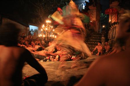 kecak: Blurred figure dancing during a Bali Fire Dance