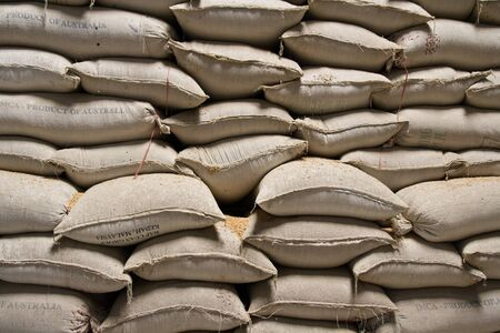 agriculture industry: Pile of rice sacks in grain warehouse, Vietnam