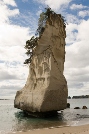 pinnacle: Pinnacle Rock in Cathedral Cove Stack, Coromandel, New Zealand Stock Photo