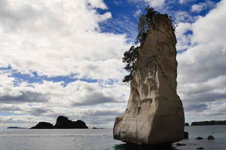 pinnacle: Pinnacle Rock in Cathedral Cove Stack, Coromandel, New Zealand Stock Photo