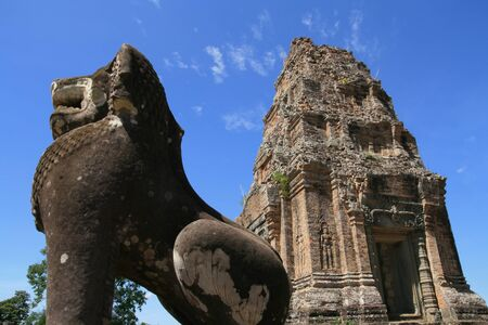 Lion Statue stands guard in Angkor Thom, Cambodia, Asia Stock Photo