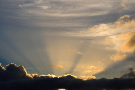 busts: Sunbeam busts through clouds like a heavenly image of bright light Stock Photo
