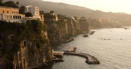 Sun sets over the bay in Sorrento, Campania, Italy.