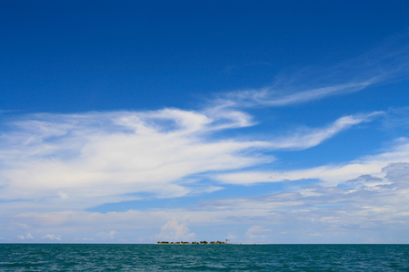 unaffected: Tiny tropical island sits isolated in the ocean Stock Photo