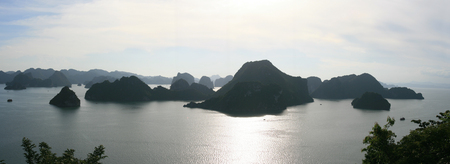 approaches: Peaceful Halong Bay as evening approaches in Vietnam Stock Photo