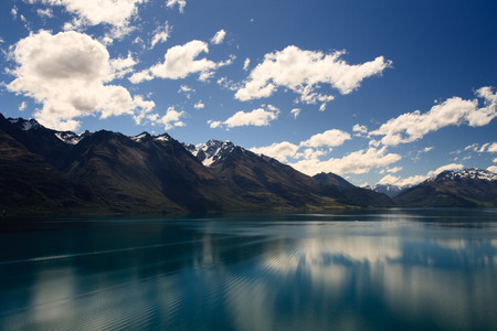 south island new zealand: Reflection from Lake Wakatipu surrounded by mountains near Queenstown, South Island, New Zealand